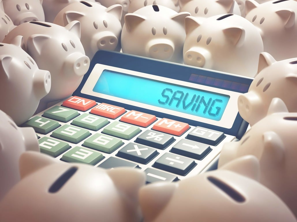 Calculator surrounded by money banks with the word 'saving' written on it